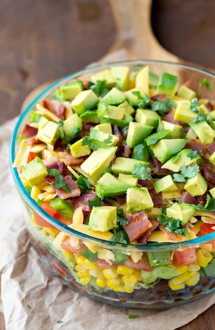 Southwestern layered salad is an easy, layered salad that's packed with delicious southwestern flavors. Great summer lunch or dinner!