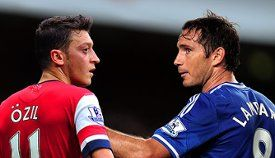 Arsenal take on title rivals Chelsea