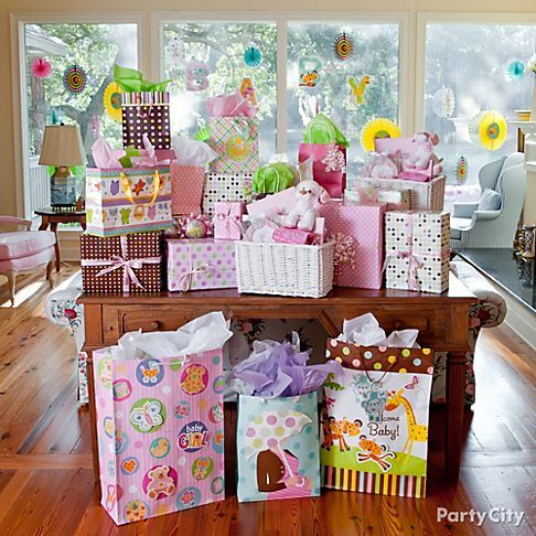 Baby shower gifts can be as pretty as the shower decorations, so why not show them off?