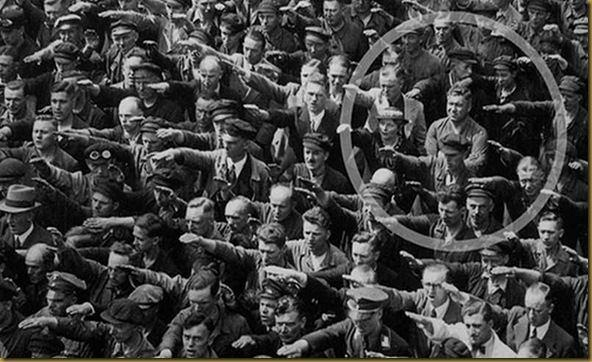 Ordinary people. The courage to say no. The photo was taken in Hamburg in 1936, during the celebrations for the launch of a ship. In the crowed, one person refuses to raise his arm to give the Nazi salute. The man was August Landmesser. He had already been in trouble with the authorities, having been sentenced to two years hard labour for marrying a Jewish woman.   We know little else about August Landmesser, except that he had two children. By pure chance, one of his children recognized ...