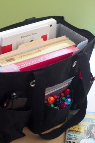 Organizing Utility Tote: school books in main compartment, use the side pockets for markers, stapler, calculator etc.
