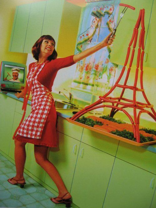 Della realized she probably shouldn't have had BOTH the expresso double-shot AND the Red Bull the same morning... On the other hand, it was true that she had never made an Eiffel Tower out of wieners before...