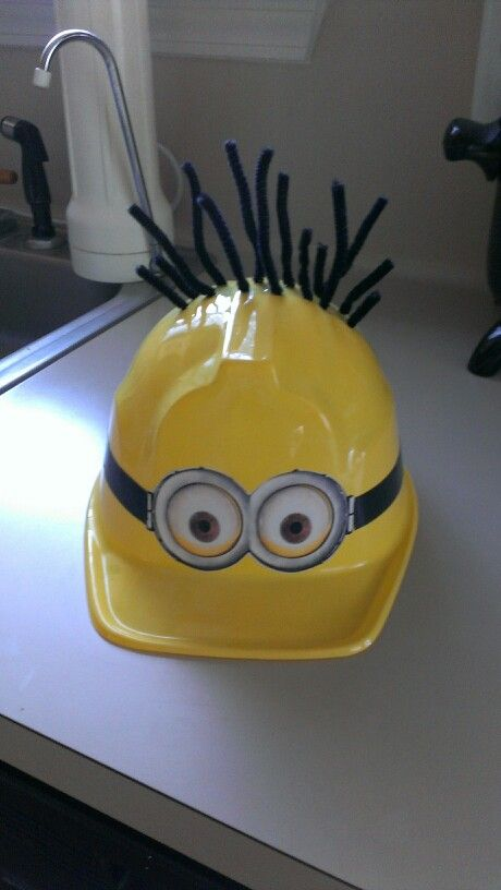 My #minion #costume hat. Pipe cleaners, plastic hat from party store, electric tape, and minion goggles printed, cut, and mod podged onto hat.  A yellow tshirt, blue jeans, black boots,  black gloves, and blue-ribbon suspenders