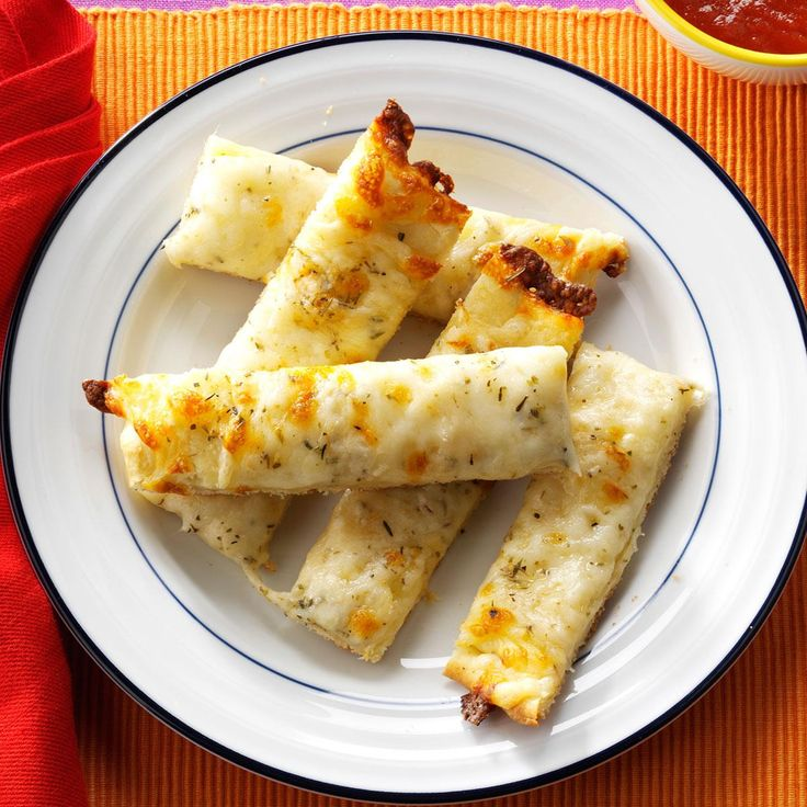 Herbed Cheese Sticks Recipe -We love the breadsticks at our local pizza joint. Now I can get that same gooey-from-the-oven treat, but I never have to leave the house. —Heather Bates, Athens, Maine