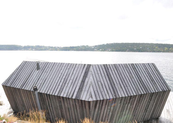 Pine-clad sauna by Murman Arkitekter sits on the Stockholm archipelago.