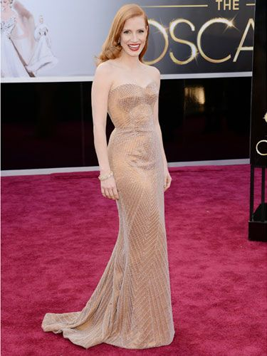 Jessica Chastain in Armani Prive. Stunning in the light gold tone.