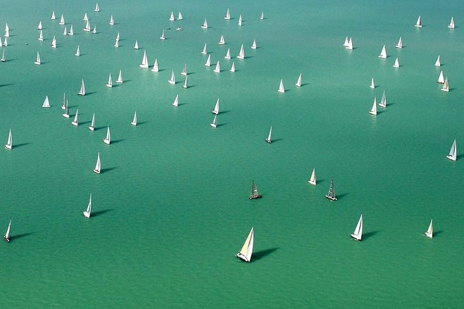 Competitors sailed after the start of the three-day Blue Ribbon yachting race around Lake Balaton in Hungary on Thursday. This year, around 570 sailboats started the largest round-the-lake yachting race of Europe.