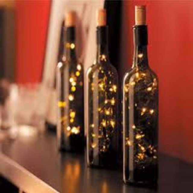 Now this is brilliant. the use of old wine bottles and what i can only imagine as solar lights, gives the impression of fireflies caught in a tinted bottle. has a very mood setting feel.