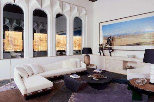 """The French-Portuguese duo Jacques Bec and Artur Miranda, also known as Oitoemponto, created a """"grand zoological living room"""" that evokes the suave 1970s """"James Bond style,"""" a kind of jet-set chic. Even the walls hide an ingenious gadget: the sleek arched niches are activated by remote control, which can reveal or conceal a collection of some 43 rare zoological figurines by the late Portuguese silversmith Luiz Ferreira."""