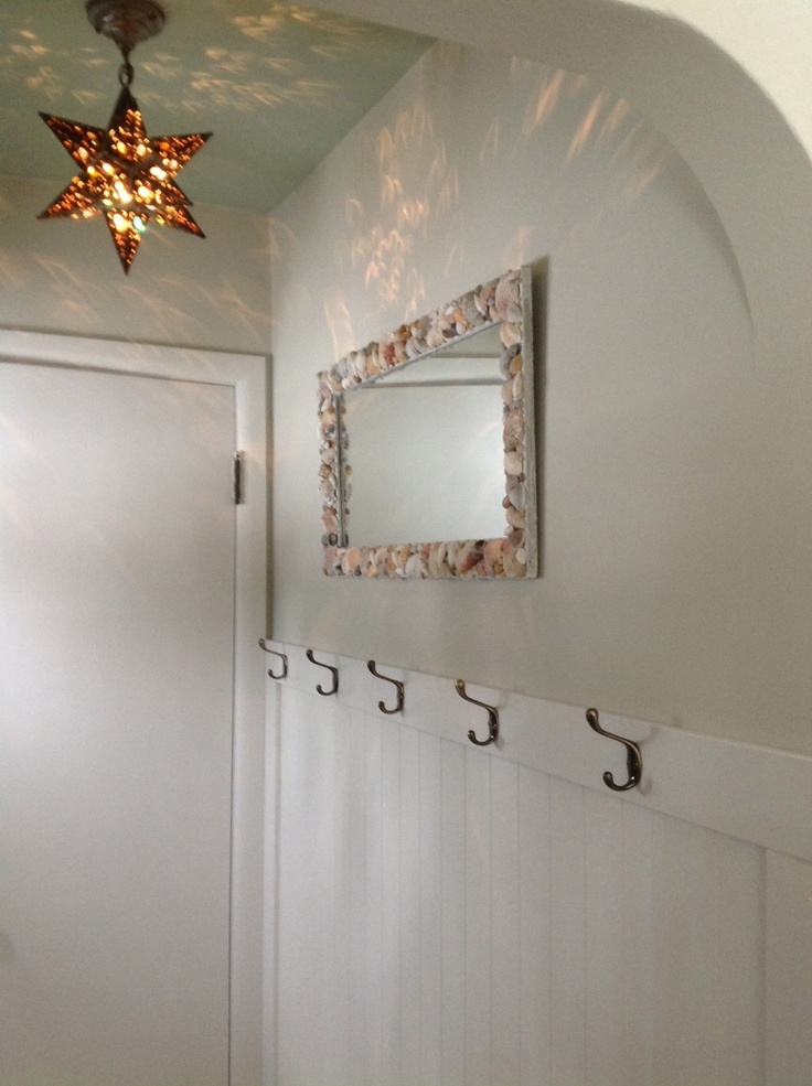 Entry Redesign Finished With Wainscot Coat Hooks