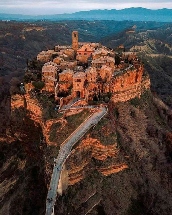 Civita di Bagnoregio. We stayed here for a week when we went to Italy, so beautiful!