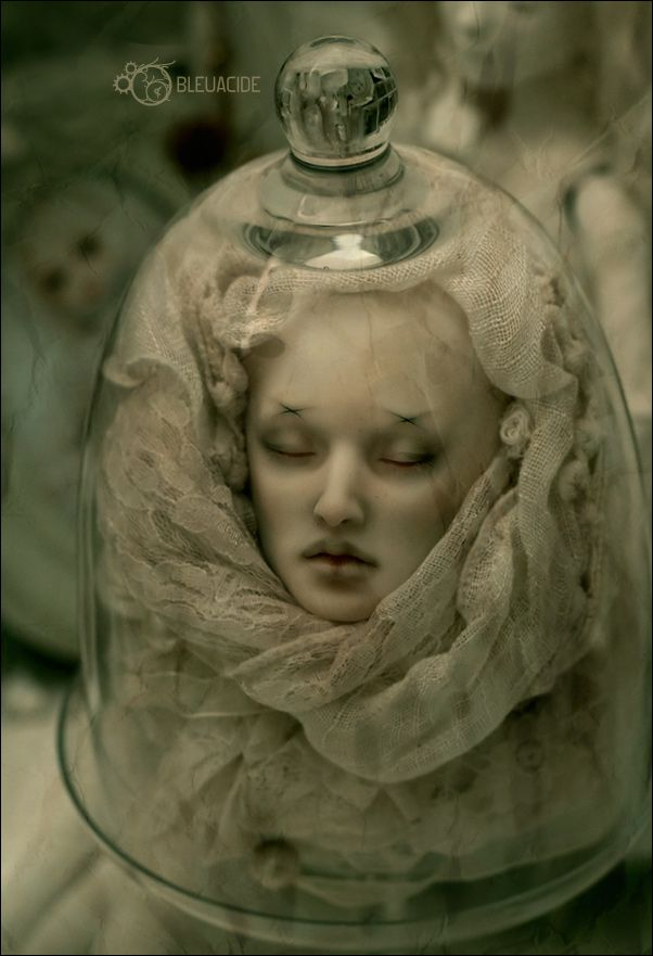 Use a porcelain doll head, glass display and a lace scarf.