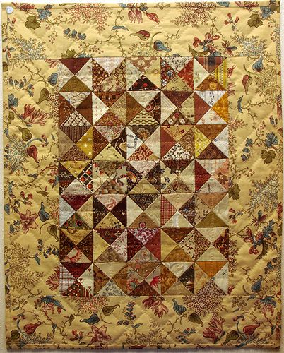 miniature quilt with yellows and browns