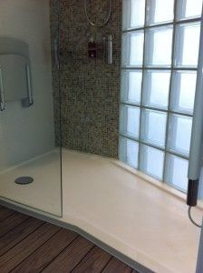 Bespoke Shower Tray from Versital with glass block feature and pull down seat.