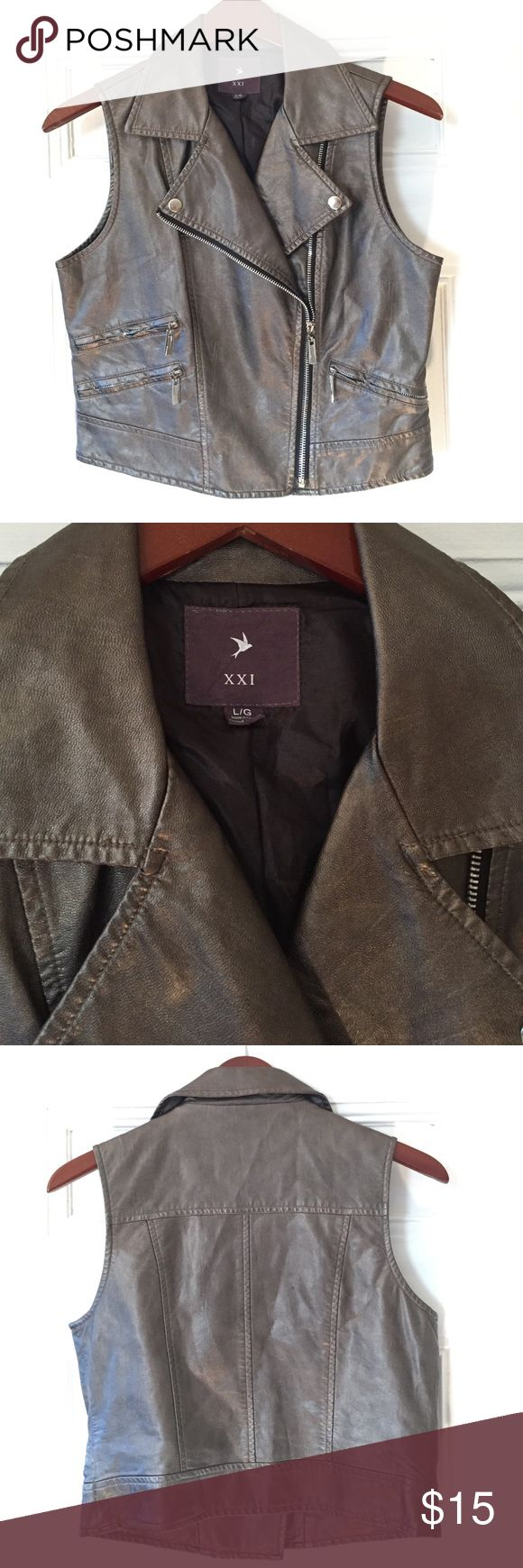 XXI Forever 21 Faux Leather Metallic Vest Sz L XXI Forever 21 Women's Faux Leather Metallic Vest Sz Large in EXCELLENT condition. It does not appear to have been worn. Silver/great metallic. Forever 21 Jackets & Coats Vests