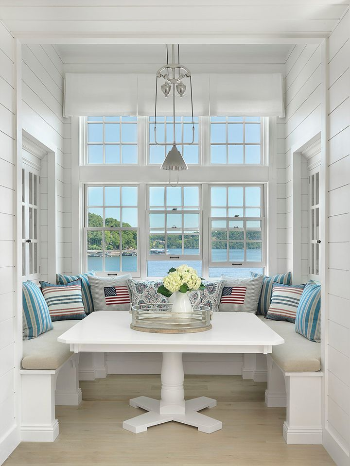 Coastal inspired kitchen nook with large windows
