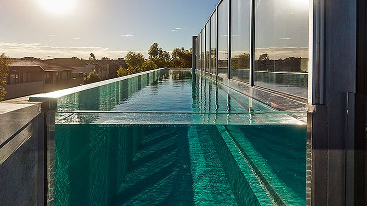 Lap Pool With Acrylic Window Constructed On The Side Of A Three Storey House Pinned To Pool