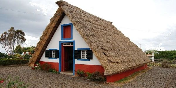 Triangular House Design Found in Portugal with Thatched Roof