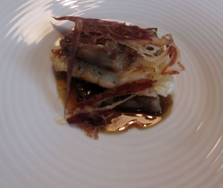 Tradition, ocean and land: braised IBERIAN PORK TAILS AND PAN FRIED LANGUSTINES. June 2010. Photo: N. Moropoulos