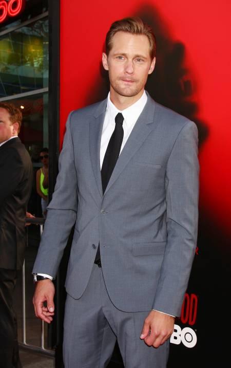 True Blood hunk Alexander Skarsgard walks the season 6 red carpet in Los Angeles
