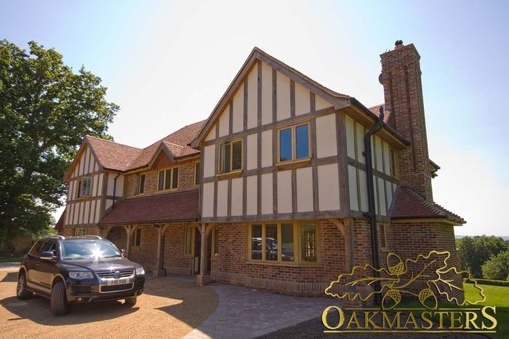 External house cladding - Oakmasters -This hybrid house is build using a combination of masonry, solid oak frame and external oak cladding