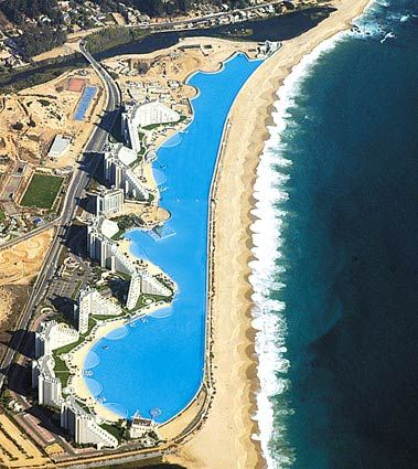 """World's largest swimming pool, Chile  (Crystal Lagoons)  Thinking about swimming a few laps before breakfast?    Check out this man-made """"lagoon"""" — dubbed the world's largest outdoor swimming pool — at the San Alfonso del Mar vacation property resort at Algarrobo, Chile.    The coast-hugging pool is all man-made with a bit of patented technology that uses water from the nearby Pacific Ocean to fill it.    According to the Guinness World Records, which deemed it the world's largest pool in…"""