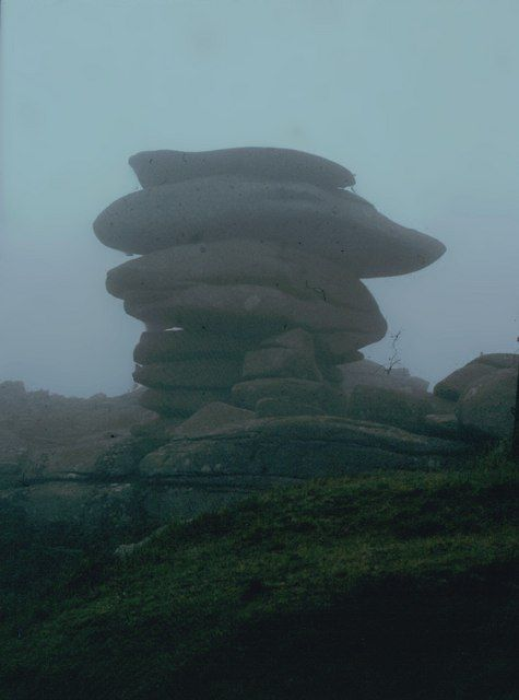 The Cheesewring Stones standing above a disused granite quarry.
