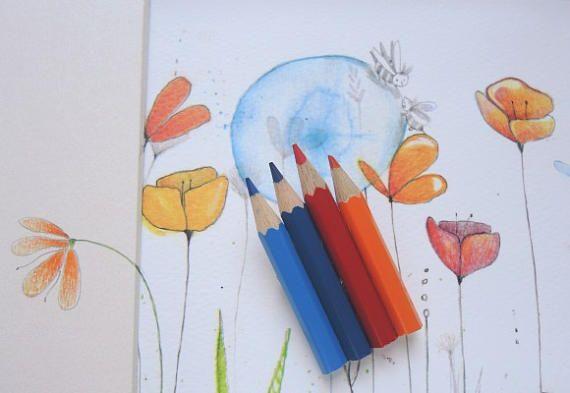Grande spilla con matite colorate arancioni, azzurre e blu
