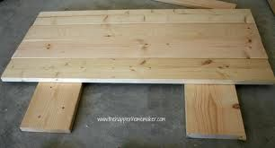 DIY headboard 4 pine boards for headboard and 4 for legs to bolt to frame.. Stain or paint.. so easy so cheap!