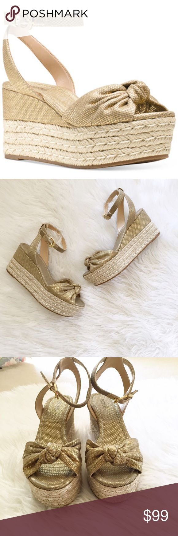 FLASH SALE⚡️NWOT Michael Kors Metallic Wedges Gorgeous NWOT Michael Kors metallic espadrilles wedges with a bow detailing. So cute! These would look adorable with skinny jeans. 29fcdsc MICHAEL Michael Kors Shoes Wedges