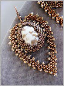 Bronze and metalllic stone earrings using peyote stitch. Beautiful!