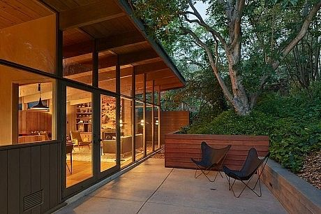 Beautifully constructed and remodeled wall of windows. Mid-Century Modern Renovation by Koch Architects
