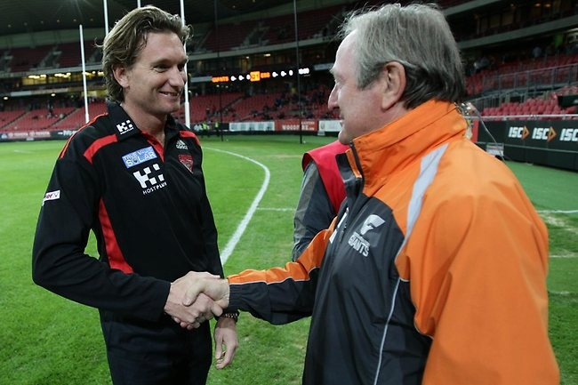 Kevin Sheedy and James Hird shake hands before the start of the match. Picture: Rohan Kelly
