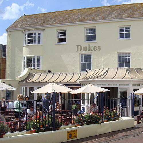Dukes, Sidmouth. At the centre of the Esplanade in Sidmouth with a large seating area to the front. Dogs welcome in the bar and informal dining area and blankets provided for owners who would rather sit outside.