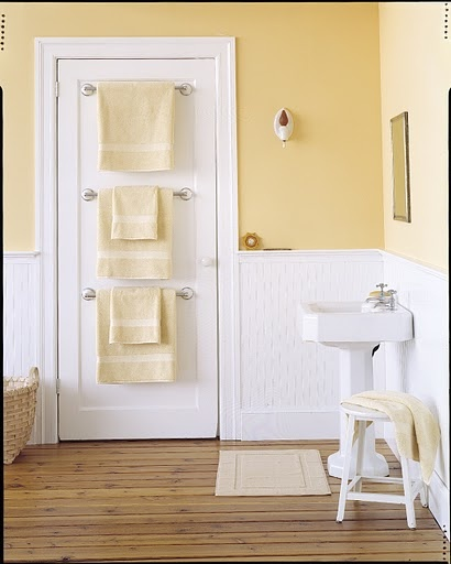 Three towel racks on the door. Cool idea so it doesn't clutter the wall.