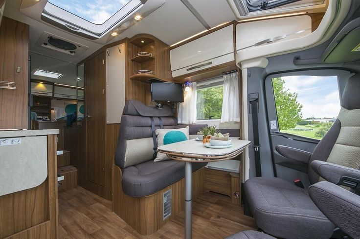 Inside the Hymer ML T580 luxury campervan:Inviting ounge takes the variability out of comfortable travel. Feel free to use this image but give credit to http://smartrv.co.nz/motorhomes-for-sale/german/hymer/ml-t-580-4x4
