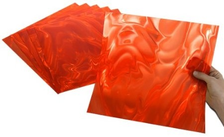 """Orange Moire - Made in the USA, translucent, easily cut with scissors, perfect for scoring, folding, embossing and die cutting! Stunningly brilliant optical effects! Add instant pizzazz to craft projects, seasonal accents, party decorations, scrapbooks, greeting cards, jewelry, furniture, frames, gifts, favors, accessories, art and DIY home decor projects. To instantly add """"POP"""" and """"WOW"""" to your projects, just add Rowlux!"""