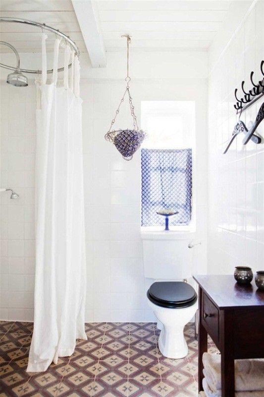 black toilet seat: vintage-scandinavian-house-bathroom-remodelista