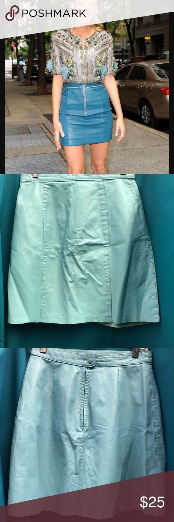 Genuine Leather Carolina Blue mini skirt Channel your inner Blake Lively! 100% Genuine Leather shell. 100% acetate lining. Zipper in back and snap button. Made in Argentina. Skirt has signs of wear as pictured. Tag says size 9/10 but it fits like a small. Brand: Comint. Carolina / Baby blue Skirts Mini
