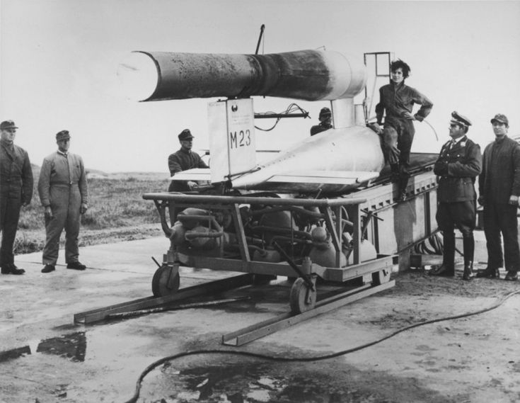 German pilot Hanna Rejch (Hanna Reitsch, 1912—1979) and military personnel люфтваффе at cruise missile Фау-1 (manned modification Fieseler Fi 103R, Reichenberg) on proving ground Rehlin (Rechlin-Lärz)