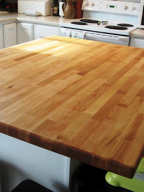 Ikea Numerar butcher block island countertop in beech, as shown on A Farewell to Can't blog.