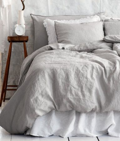 I'd like to get away from my all white bedding.... this is light gray.... hhmmm