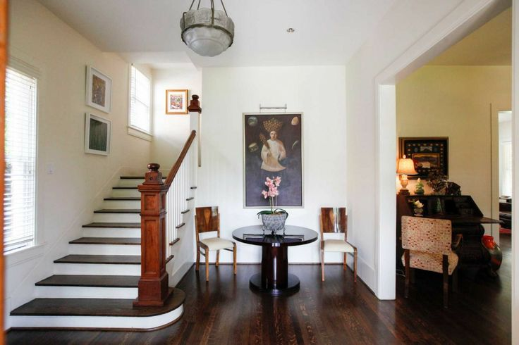 A Lalique light fixture and a pedestal table from Budapest greet visitors in the entryway of Mary & Tyler Moore's Avondale home. (Eric Kayne/For the Chronicle)