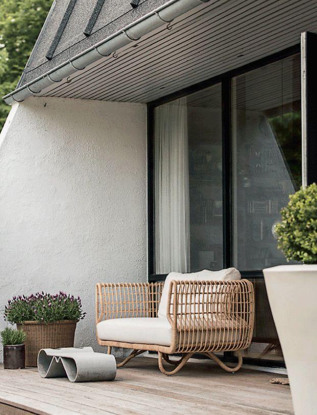 Nest in rattan sofa from Cane-line. Design by Foersom & Hiort-Lorenzen