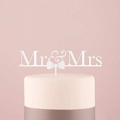 Mr And Mrs Bow Tie Acrylic Cake Topper White. Express your newly wed status on top of your cake with this classic Mr & Mrs cake topper. The addition of an adorable bow tie adds a hint of whimsy to this otherwise traditional design. Simply place the food safe stake into the top of your cake for a sweet finishing touch that's all about you.