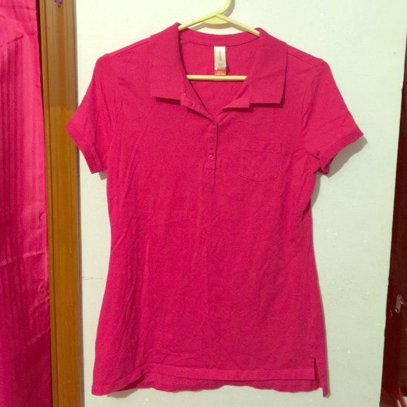 pink polo shirt with pocket Lovely pink fuchsia polo shirt with 5 buttons and cute left pocket No Boundaries Tops Button Down Shirts