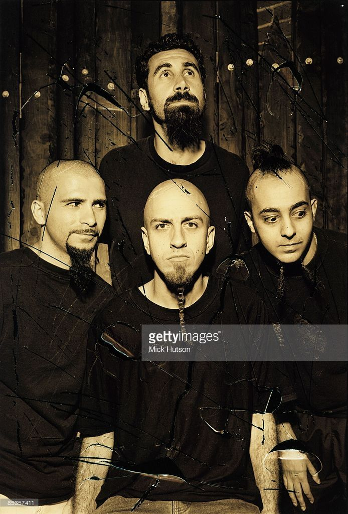 Photo of SYSTEM OF A DOWN and Daron MALAKIAN and John DOLMAYAN and Serj TANKIAN and Shavo ODADJIAN; Posed group portrait Clokwise from left John Dolmayan, Serj Tankian, Daron Malakian and Shavo Odadjian, 390