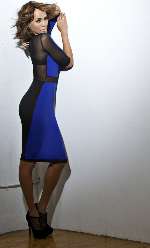 Nocole Ari Parker Kudjoe in Natt Taylor black and blue mesh body-con dress and Black Tuxedo shoes from Dillard's
