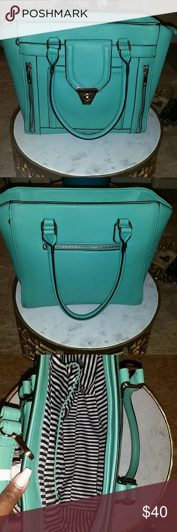 Beautiful Teal Purse Rectangular shaped Teal purse. Brand new without tags, comes with strap so it can convert into crossbody, leather like material, great condition. Bags