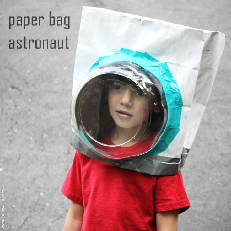 Learn how to make a paper bag astronaut helmet with an upcycled plastic cake dome, paper bag, ducktape and paint.